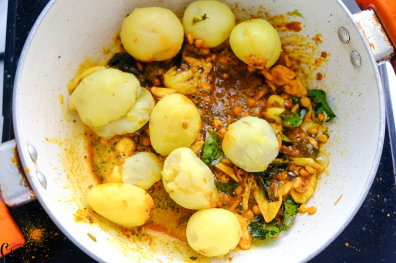 boiled potato and spices are in sauce pan