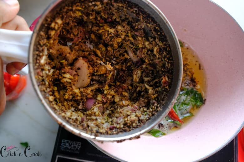 coarse mixture of onion is being added to the pan