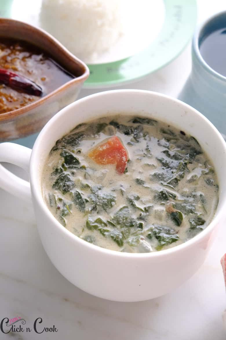 coconut milk soup is served in small white soup bowl