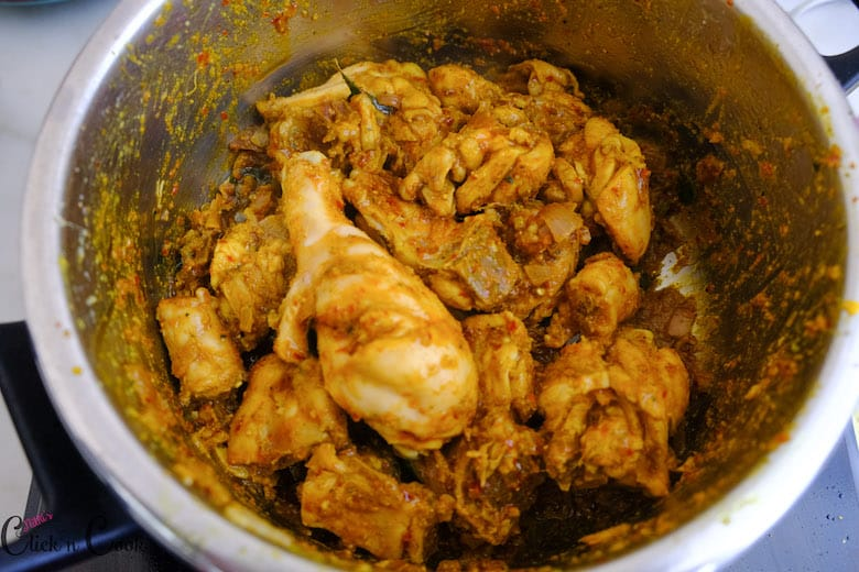 chicken is sauted with spices in deep pot