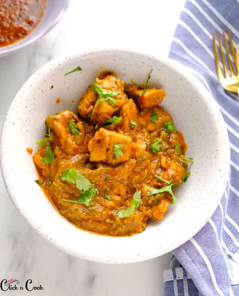 chicken curry served in bowl