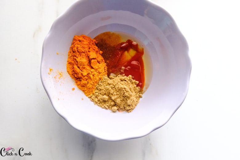 spices are in small grey mixing bowl