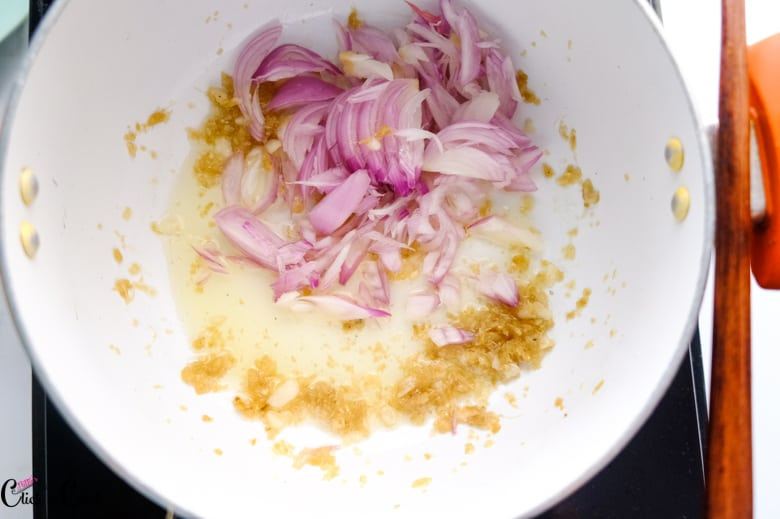 sliced onions and ginger are in saute pan
