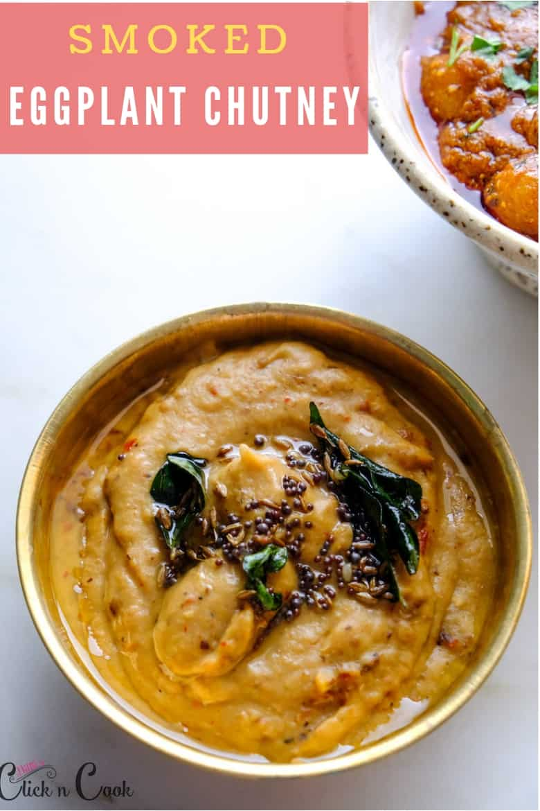 smoked eggplant chutney served in brass bowl seasoned with mustard seeds and curryleaves