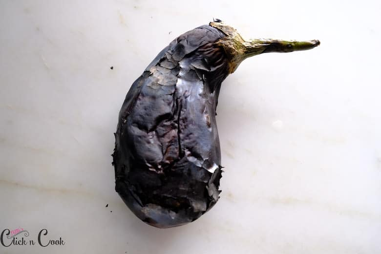 charred eggplant on white surface