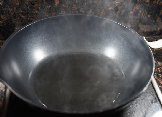 Heat up the wok, add in oil