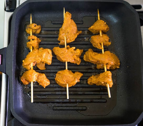 Place the marinated chicken on the griddle and turning regularly and basting with oil. Cook till the chicken is tender or charred grill marks appears.