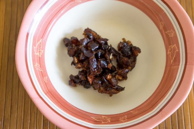 Chopped dates are placed in wide bowl
