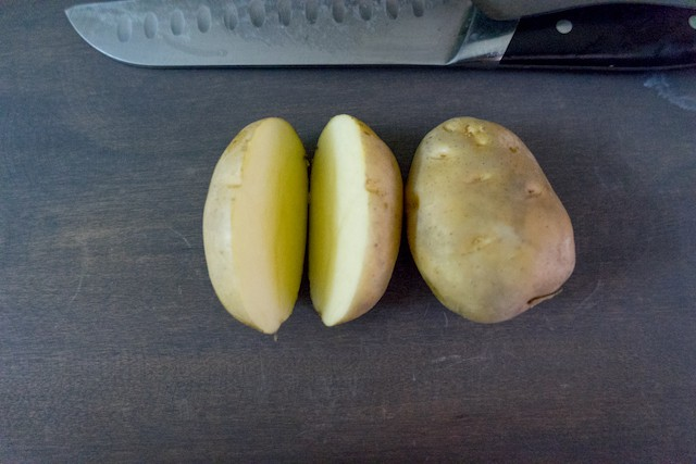 Lets cut the potato in wedges.. cut halve of the potato,