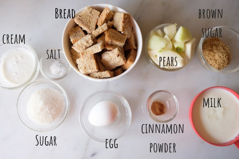 Ingredients to make pear bread pudding with caramel sauce placed in cristel bowl & white bowl