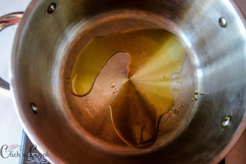 olive oil has been added into a deep sauce pan