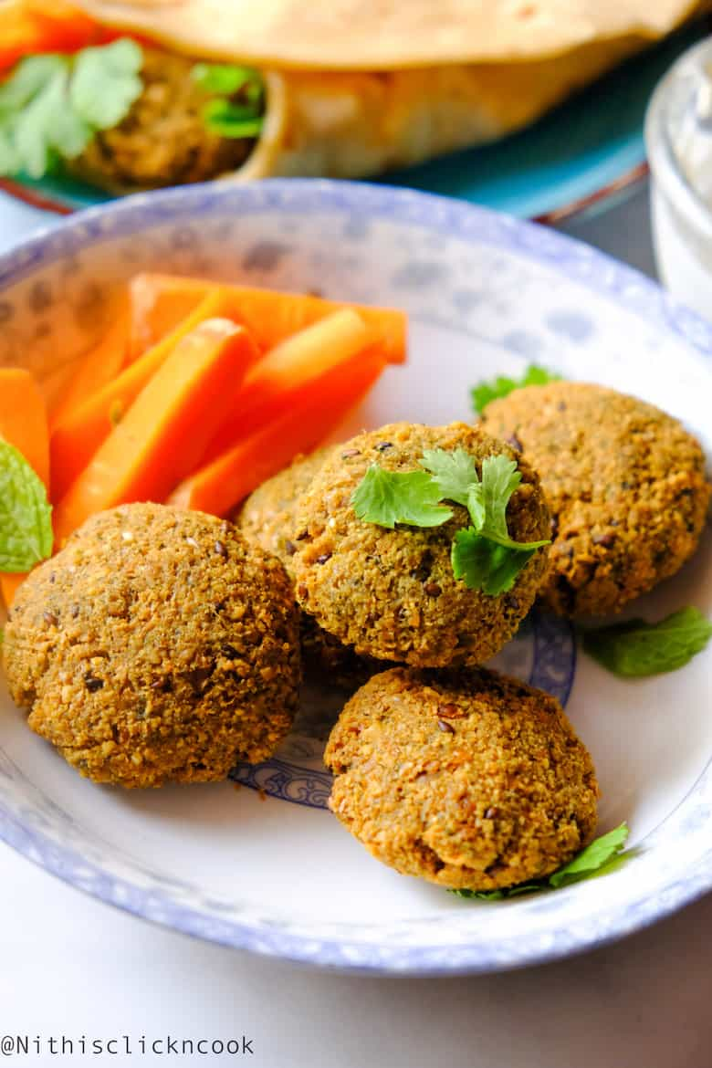 close up shot of falafel served with carrots aside