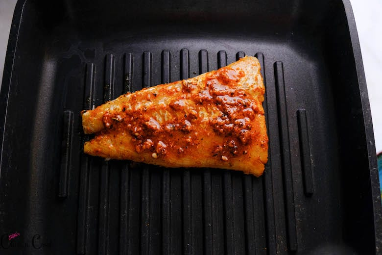 marinated fish is being grilled