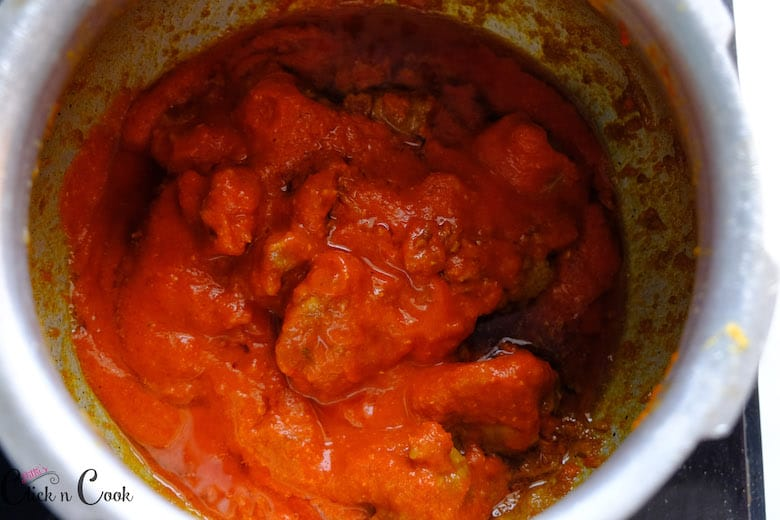 Tomato puree is added and cooked with mutton pieces