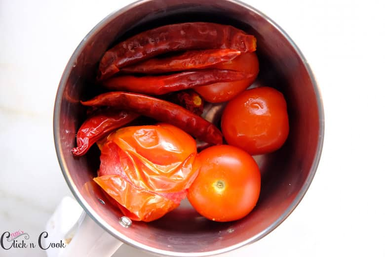 chillies and tomato are taken in blender