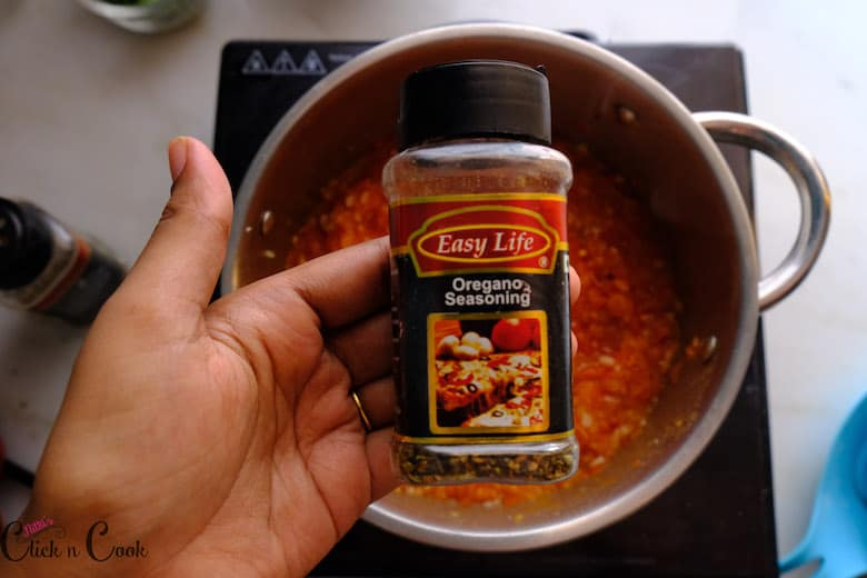 oregano is added to marinara sauce