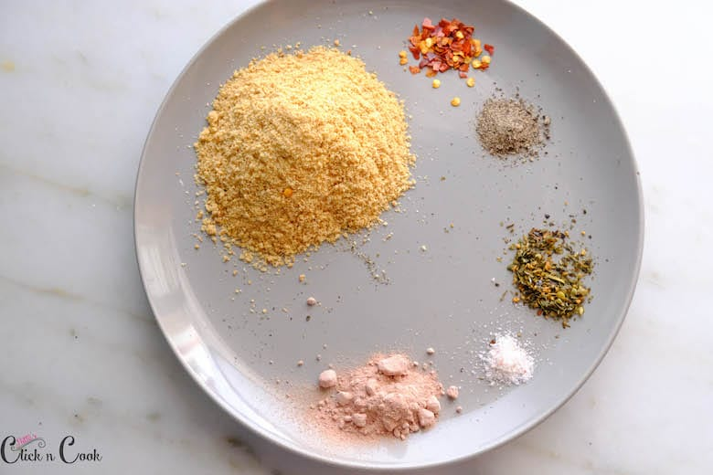 spices are taken in grey ceramic plate