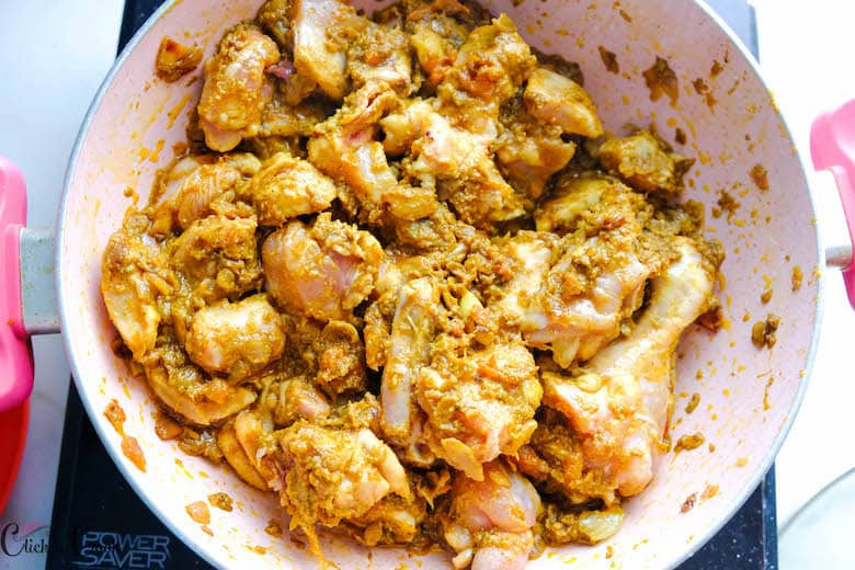 chicken is well coated with masala in saute pan