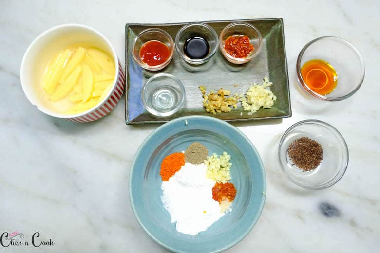 ingredients to make honey chilli potatoes are taken in bowl