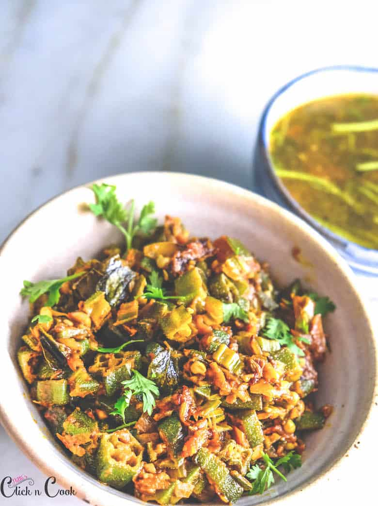 bowl of dhaba style Bhindi Masala is served along with bowl of soup aside