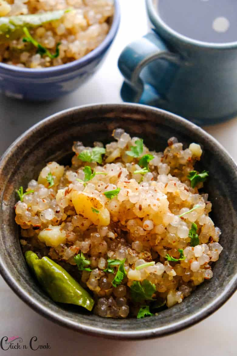 close up shot of sabudana khichdi is served in grey bowl