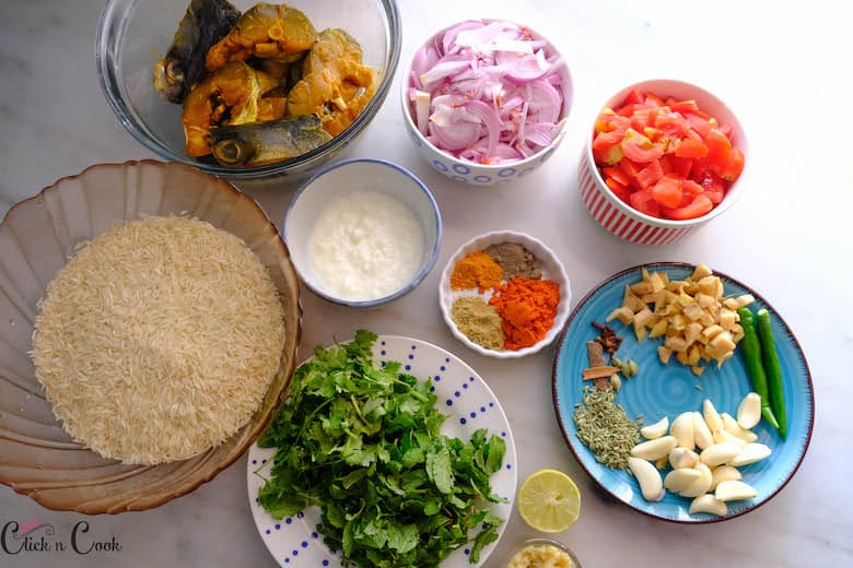 ingredients to make fish biryani is dispalyed in bowls
