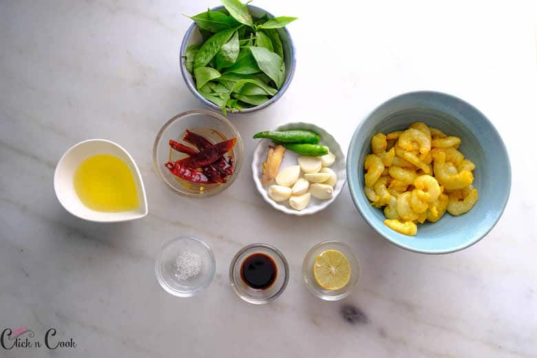 Ingredients to make Thai Basil shrimp are taken in bowl