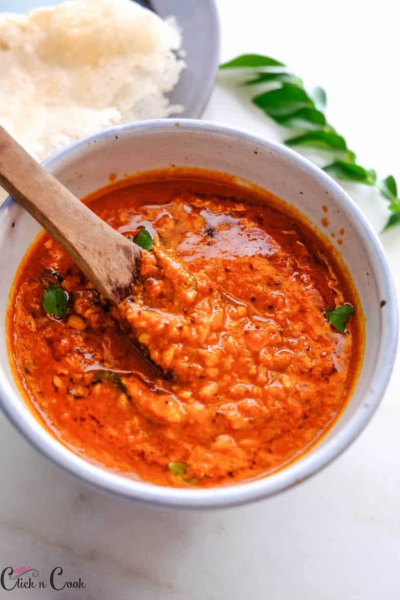 garlic chutney / Poondu chutney is served in small bowl with small wooden spoon