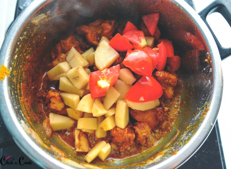 potato and tomato are added to deep pot