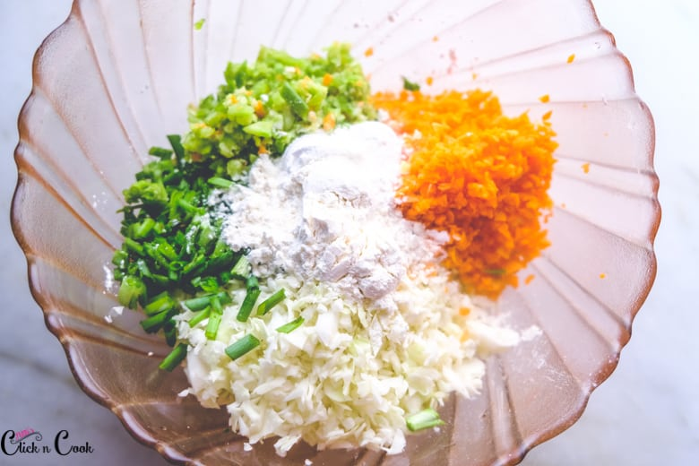 grated vegetables with flours are in mixing bowl