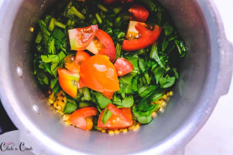 chopped tomato and spinach in pressure cooker