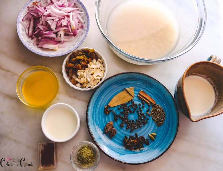ingredients to make pulao recipe are taken in glass bowls