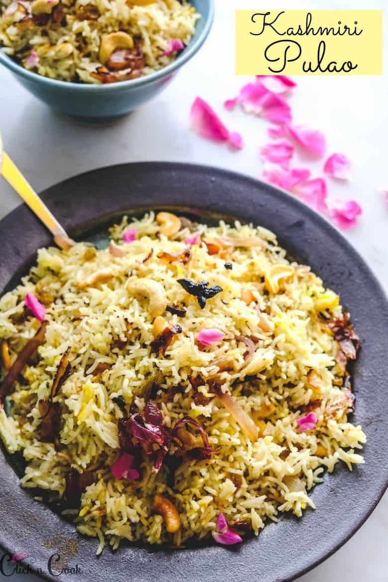 Kashmiri Pulao served in plate with bowl of rice aside