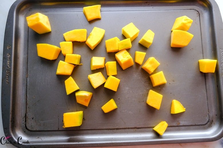 cubed pumpkin on baking tray