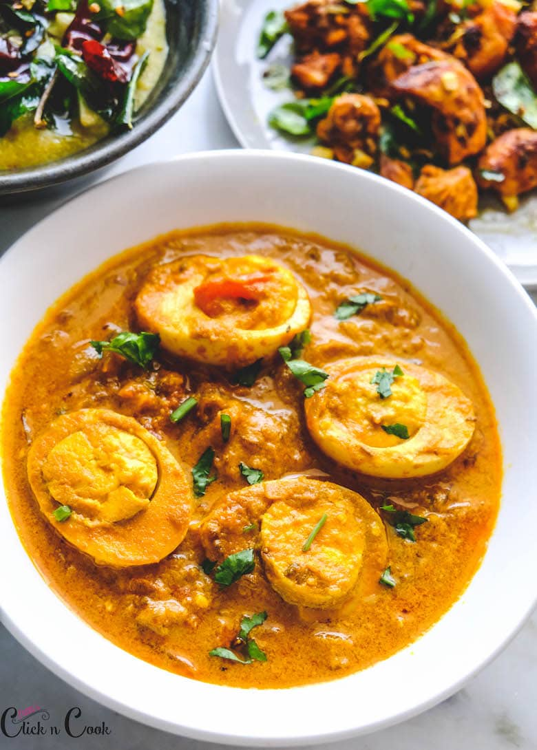 egg curry recipe Kerala style is served in white bowl