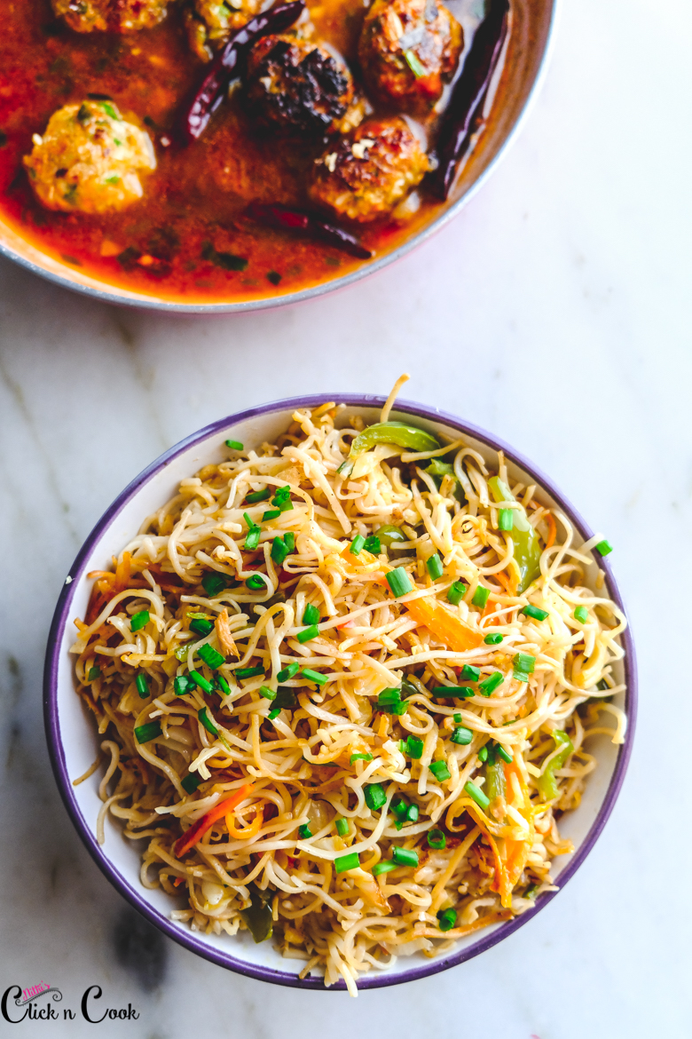 Chow mein Noodles served in bowl with curry aside