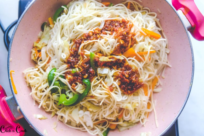 sauce is added to noodles
