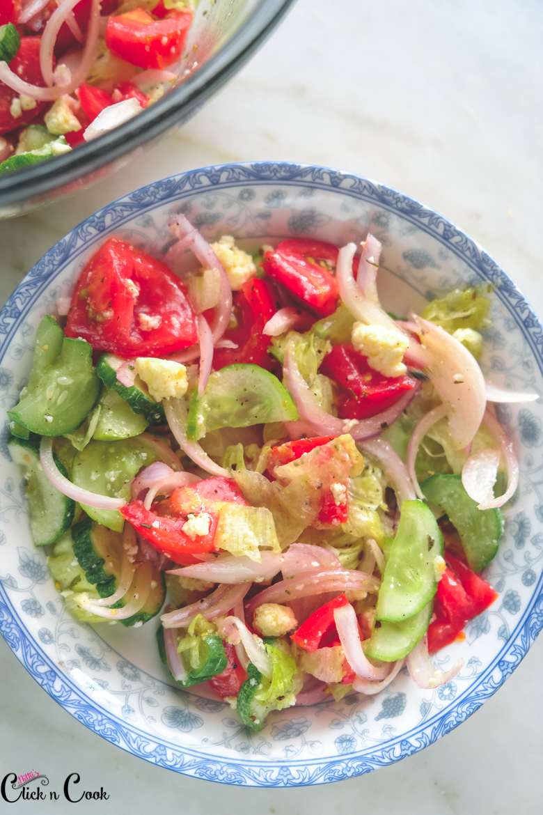 mediterranean salad chopped tomato, lettuce and cheese are in serving plate