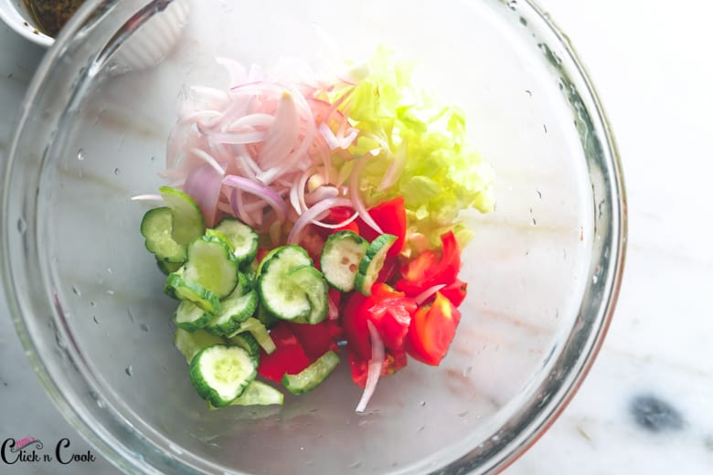 sliced veggies are in glass mixing bowl
