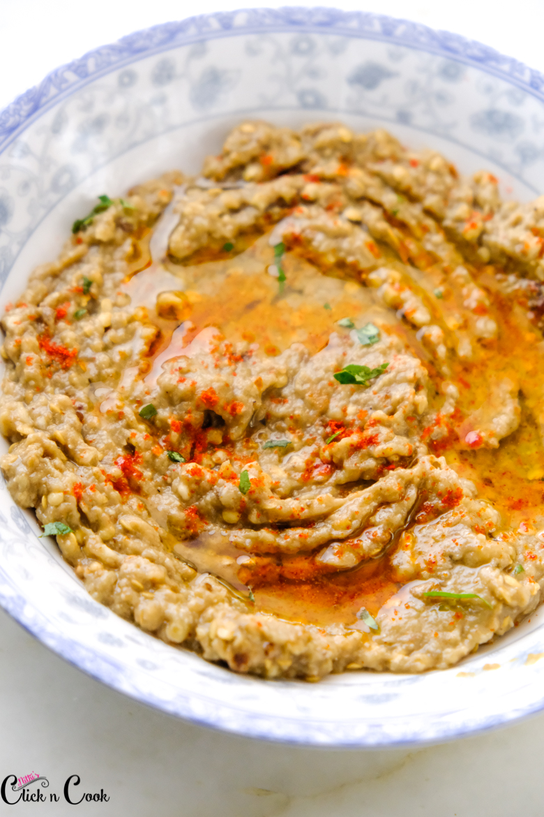 close up shot of roasted eggplant dip served in plate