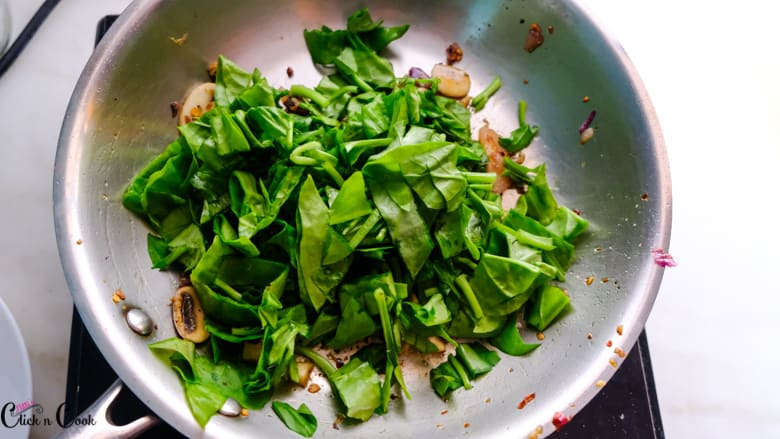 chopped spinach is added to saute pan