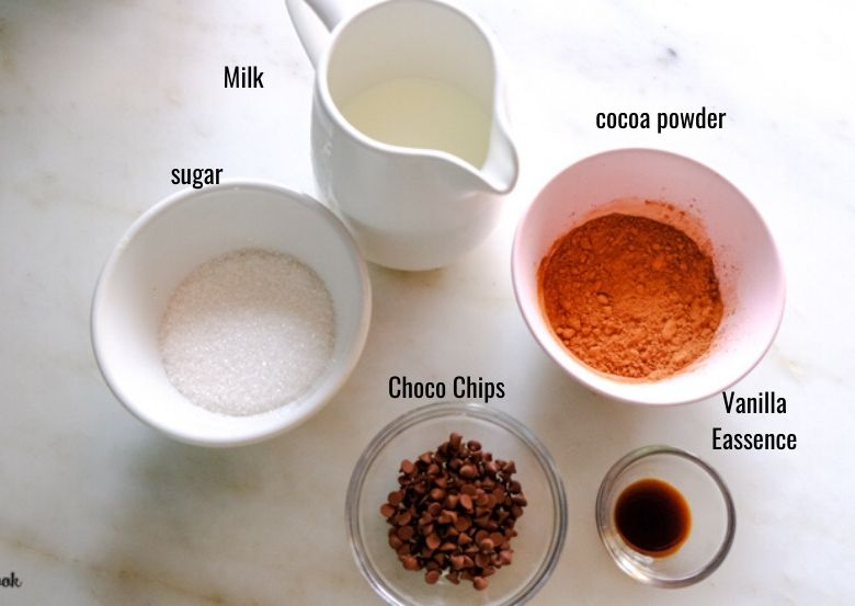 ingredients to make hot chocolate recipe are taken in bowls