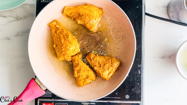 fish fry is being cooked in shallow fry pan