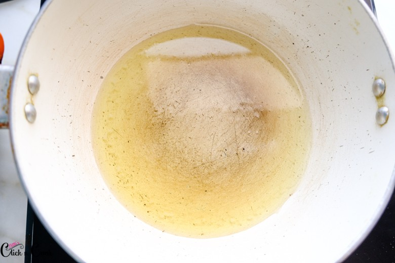 oil is being added to saute pan