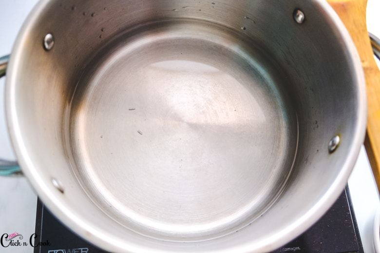 water is heated up in deep pot