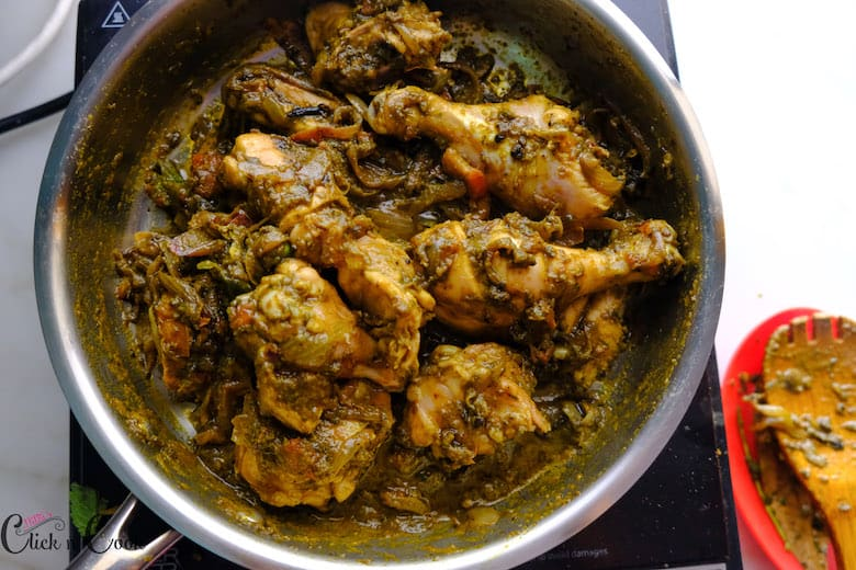 chicken with spices is being cooked in saute pan