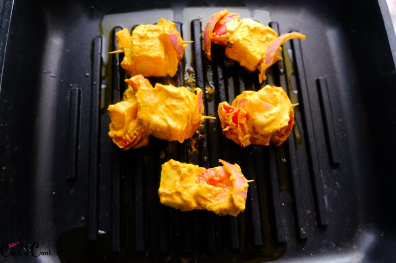paneer shashlik a marinated cottage cheese is being grilled in grill pan