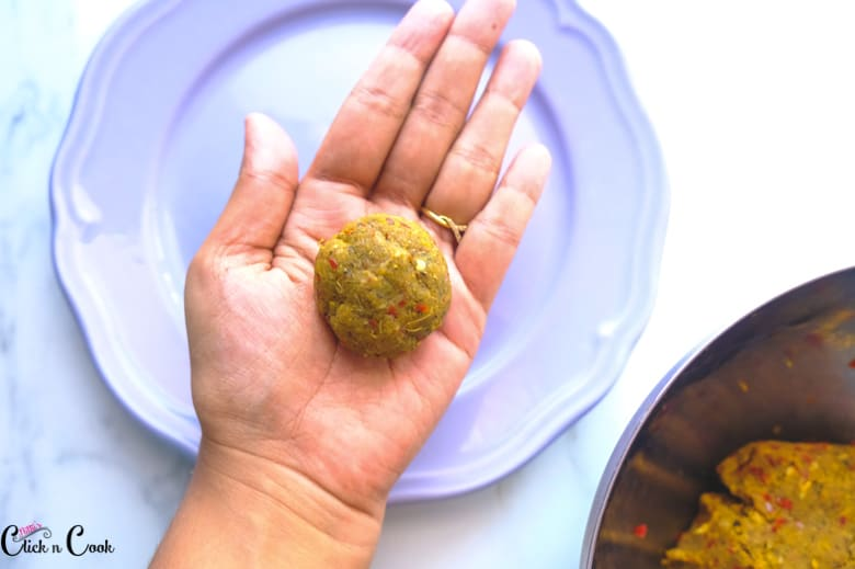 a mutton patty is kept on palm