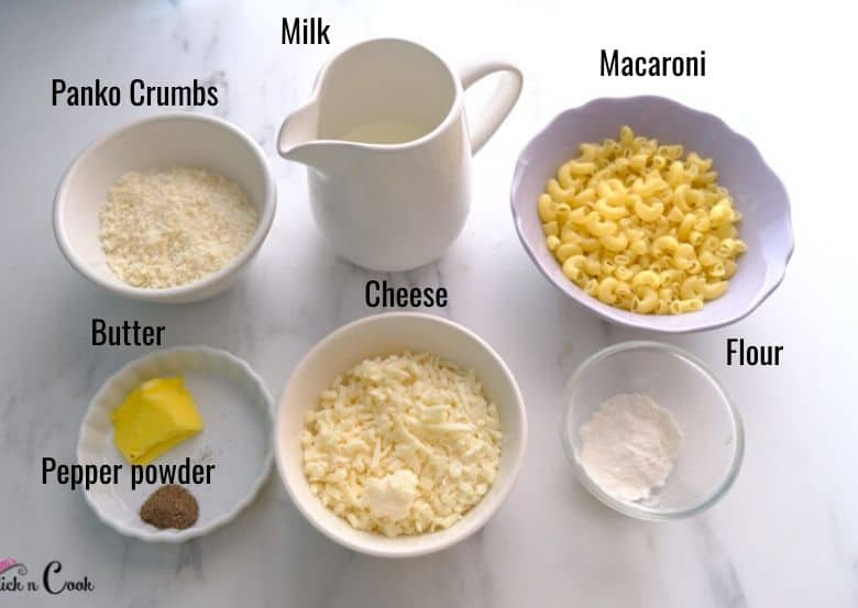 cheese, milk, butter, macaroni pasta are taken in small bowls