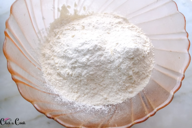 flour in the glass mixing bowl